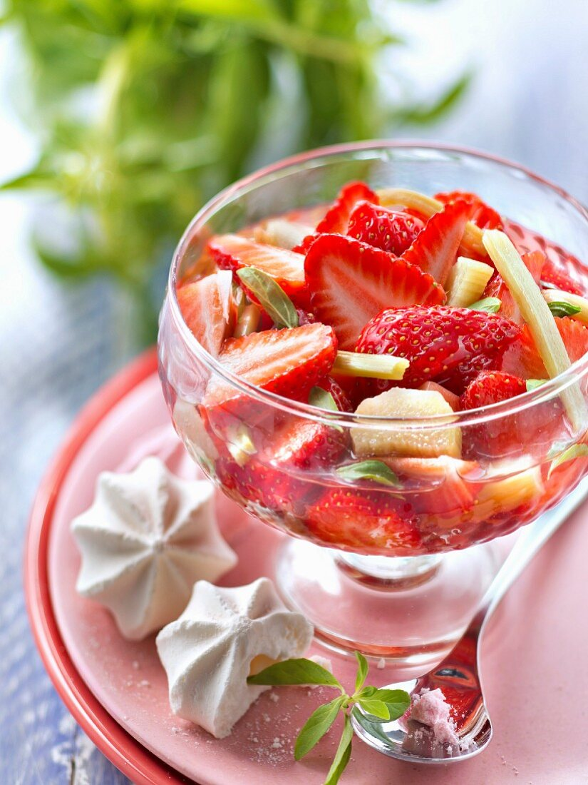 Strawberry,rhubarb and citronella fruit salad with mini meringues
