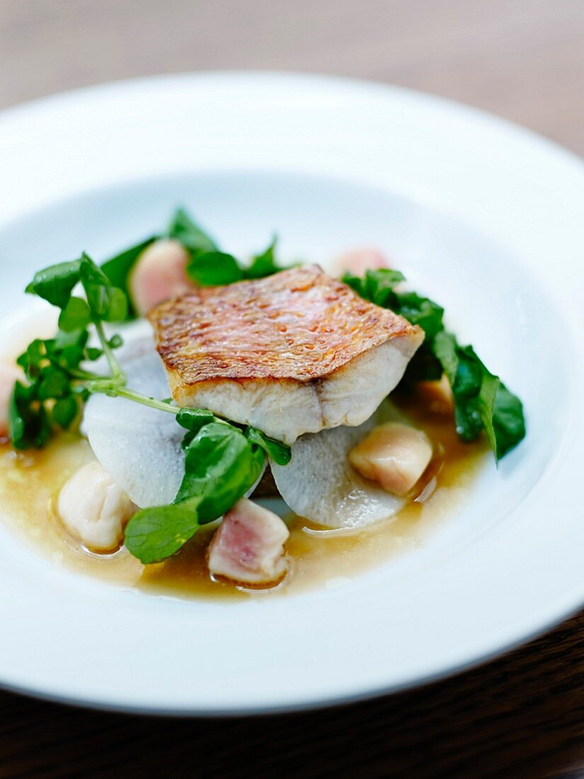 Red mullet fillet with marrow bone,white radishes and watercress