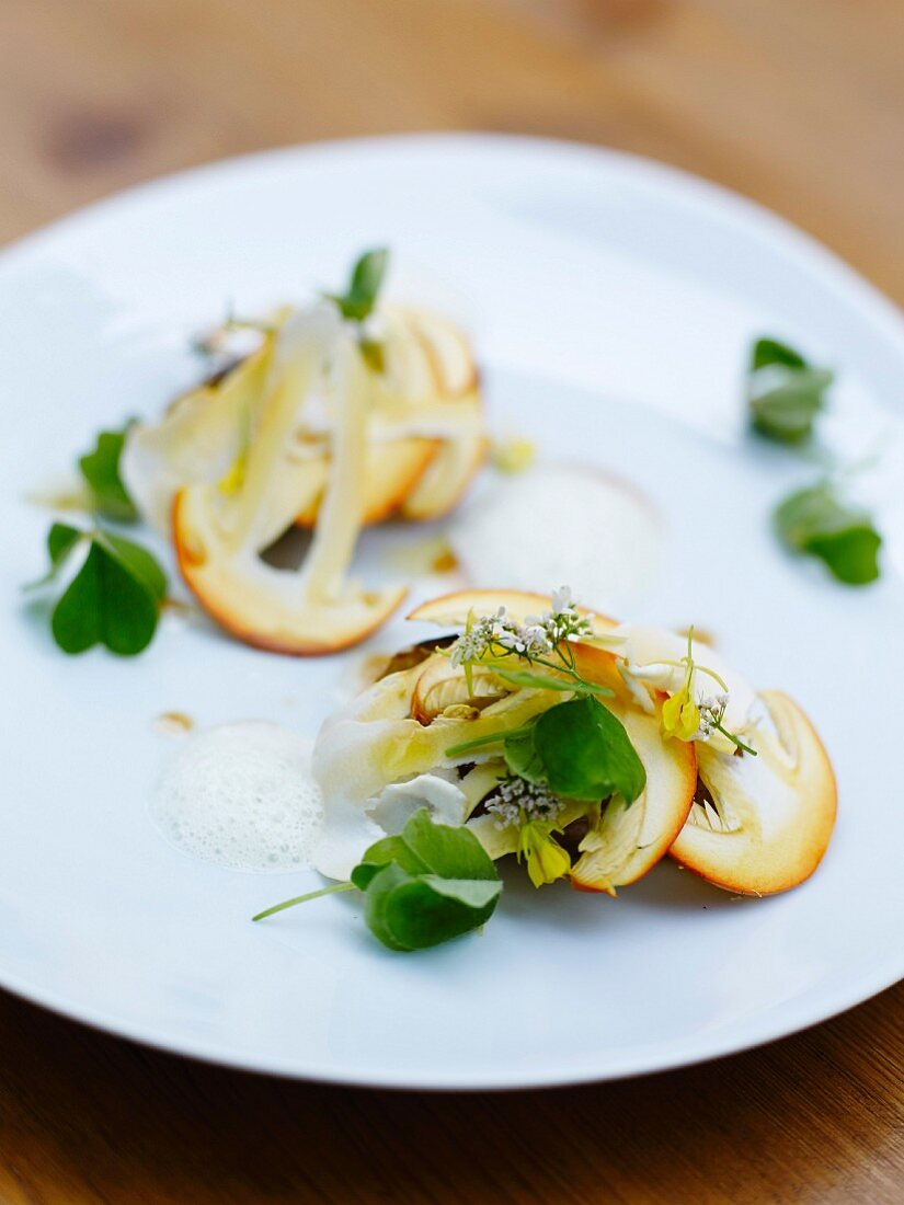 Warm orange mushroom,potato,mustard leaves and anchovy butter dish