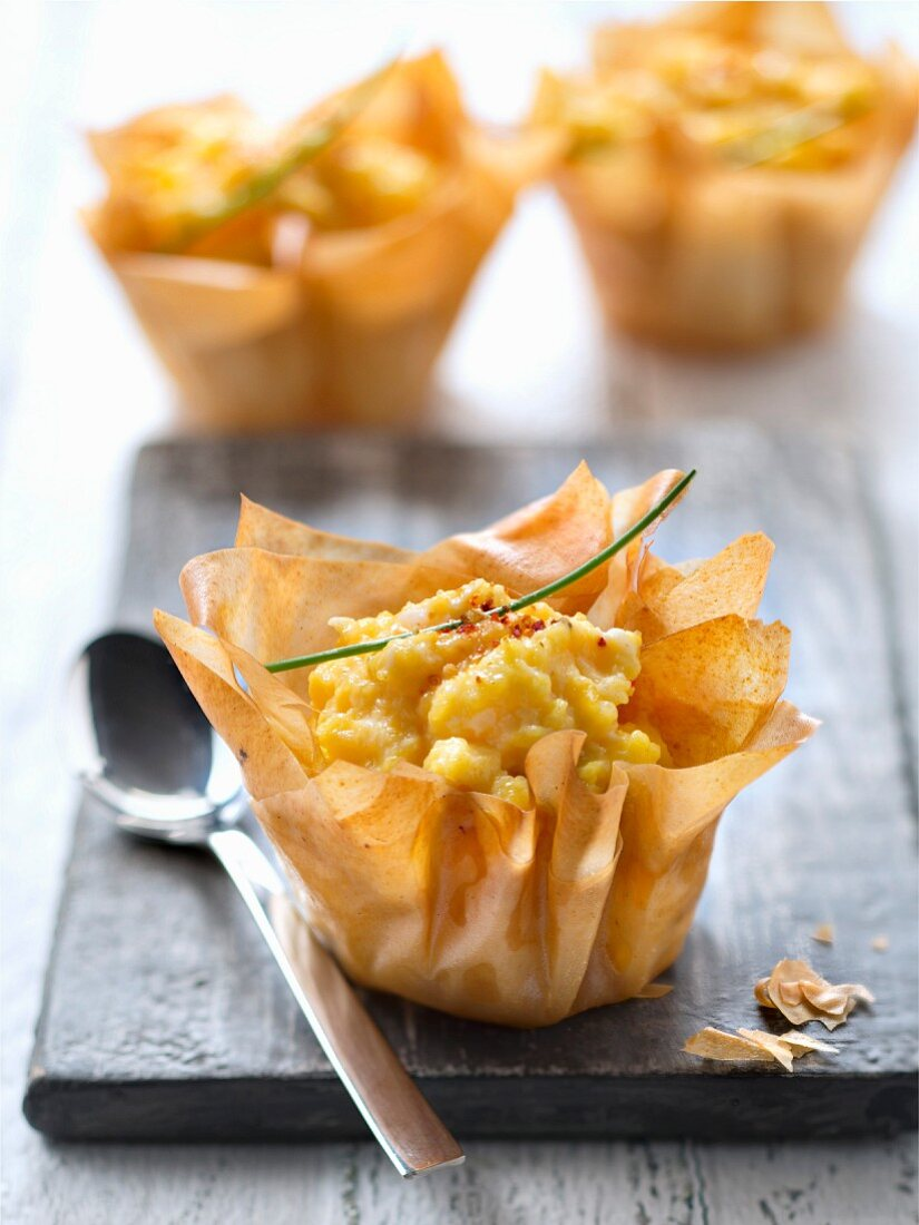 Scrambled eggs in filo pastry casing nests