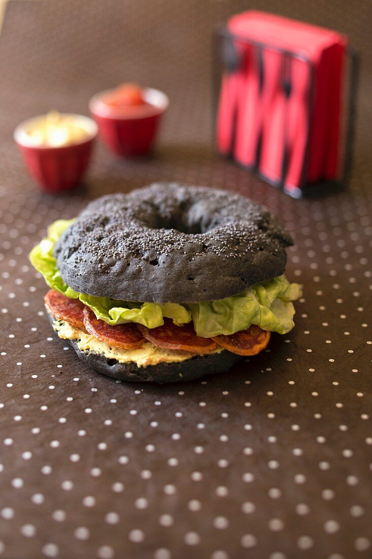 Curry paste and chorizo all black bagel