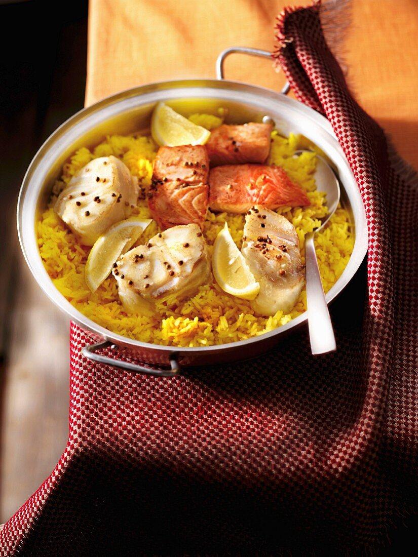 Fish Parrillada with saffron and lemon-flavored rice