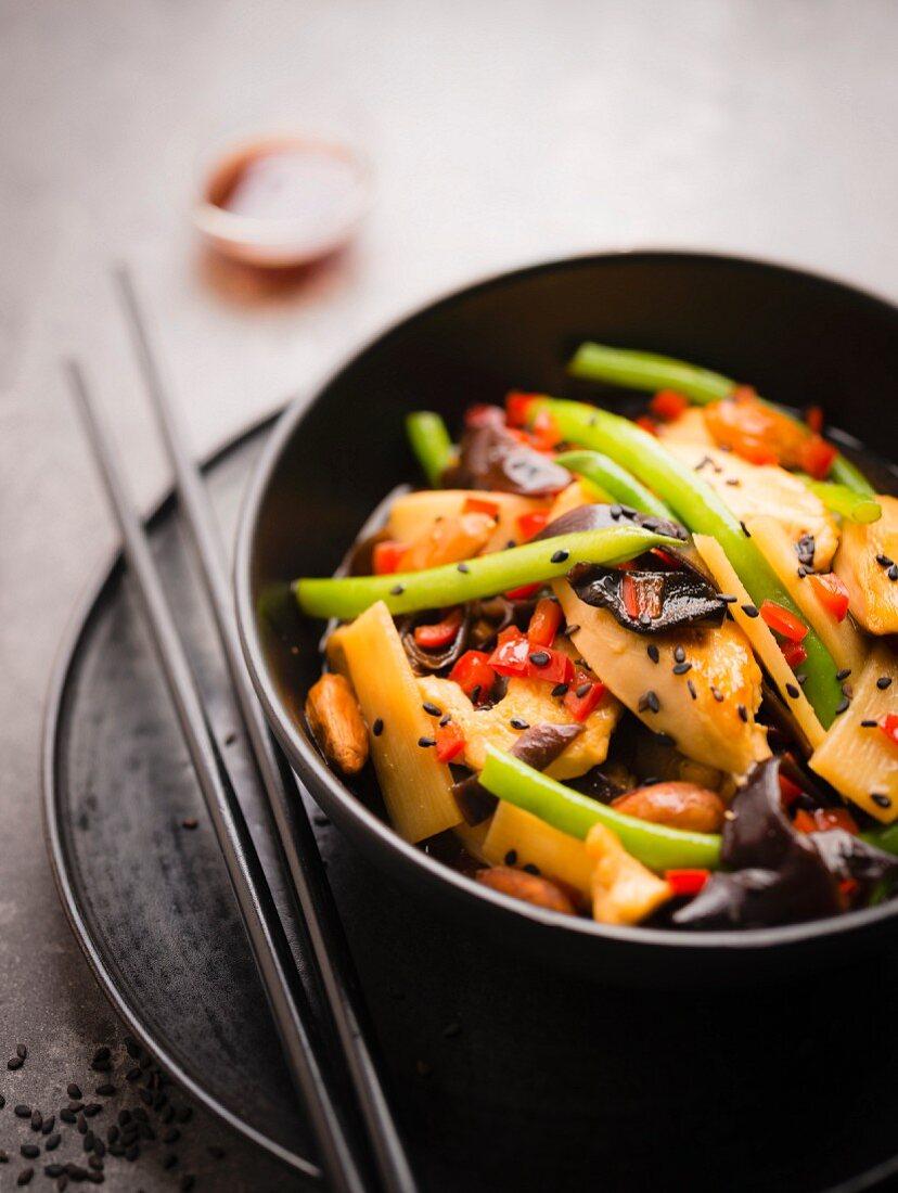 Chicken, bamboo shoots, black mushrooms, green bean, almond and black sesame seed wok