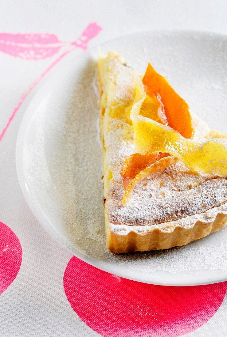 Slice of ricotta,confit orange and lemon rind pie