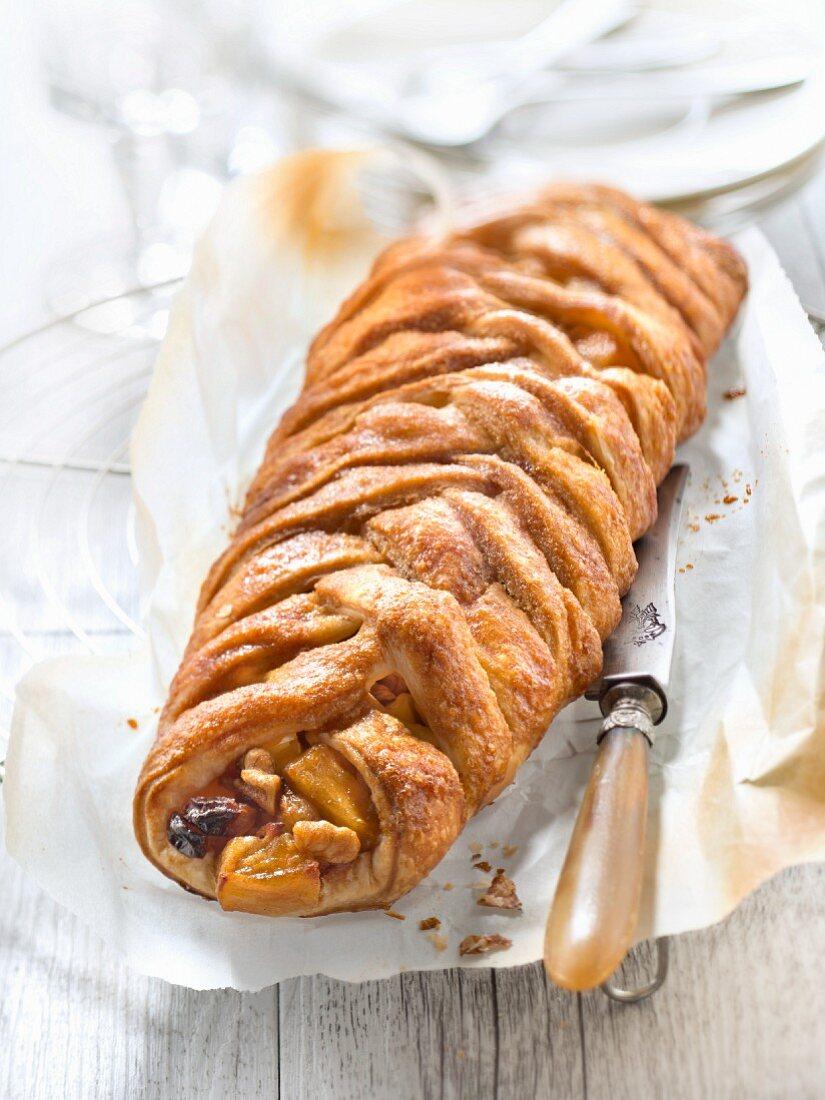 Apple,walnut and raisin pastry braid