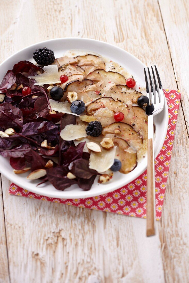 Cep carpaccio with wild berries and dried fruit,purple basil