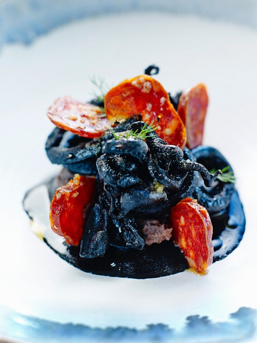 Calamay rings in squid ink with Chorizo