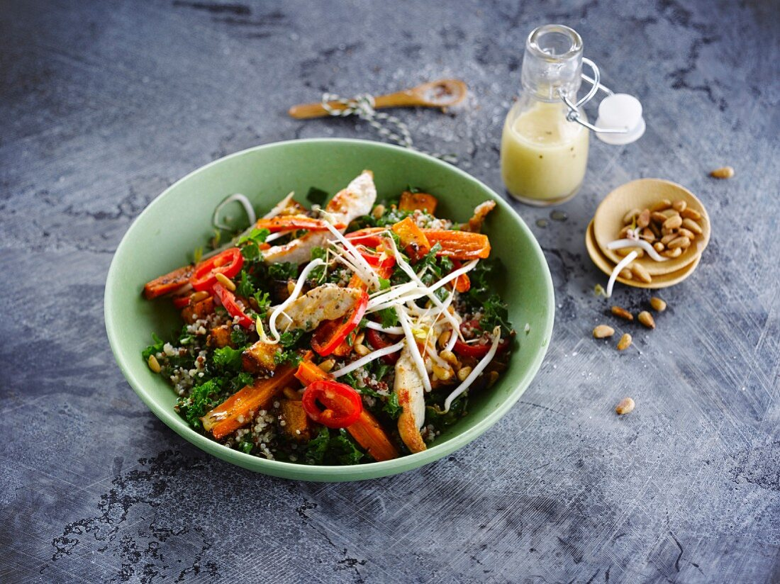 Quinoa,kale cabbage,carrot,chili pepper and sliced chicken fillet salad