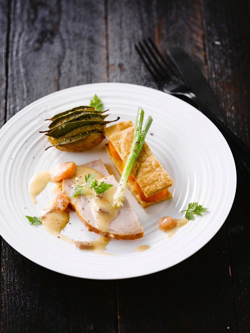 Roasted turkey with shrimp sauce,carrot mille-feuille and potato with bay leaf
