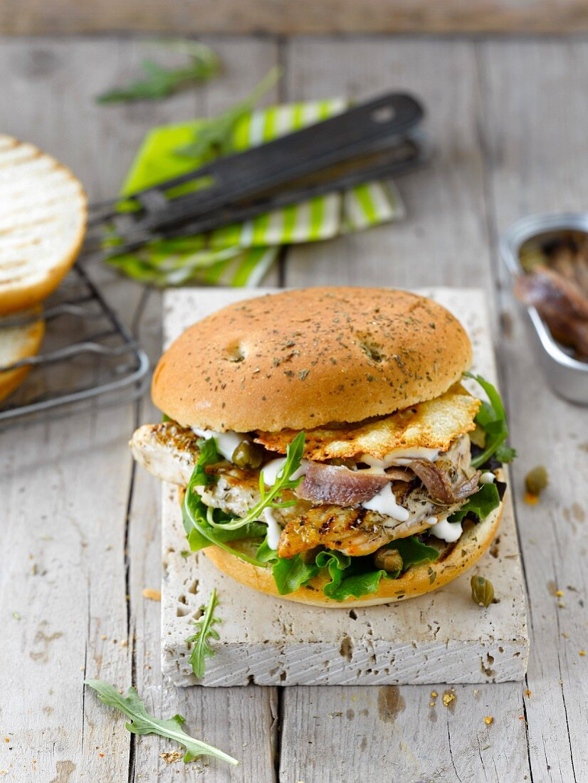 Caesar burger with chicken, anchovies and crunchy Parmesan wafer