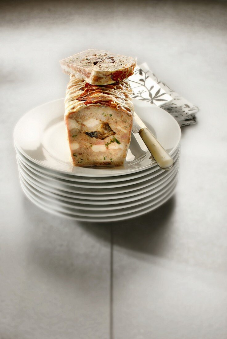 Chicken and prune wrapped in bacon terrine