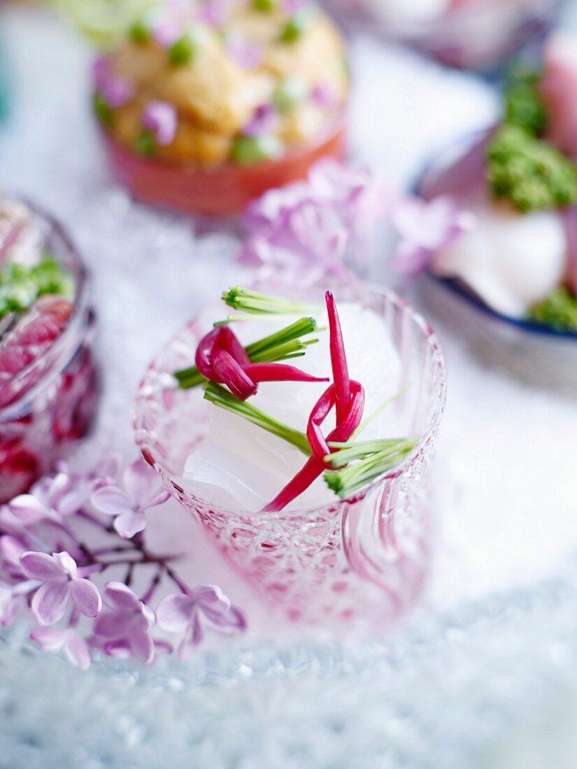 Squid sashimi in a hand-cut glass