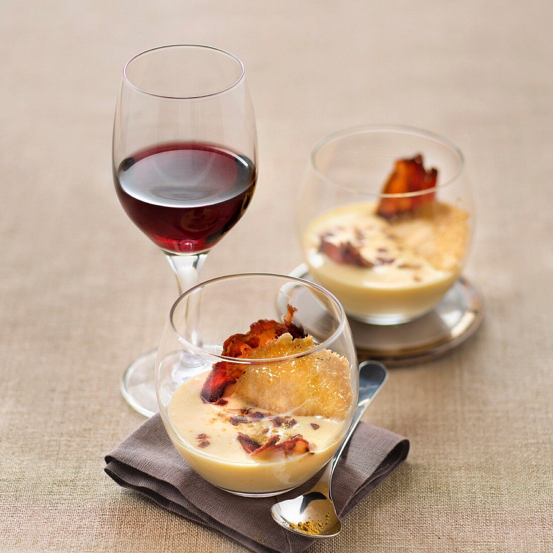 Jerusalem artichoke soup, bacon chips and parmesan tuile, glass of red wine