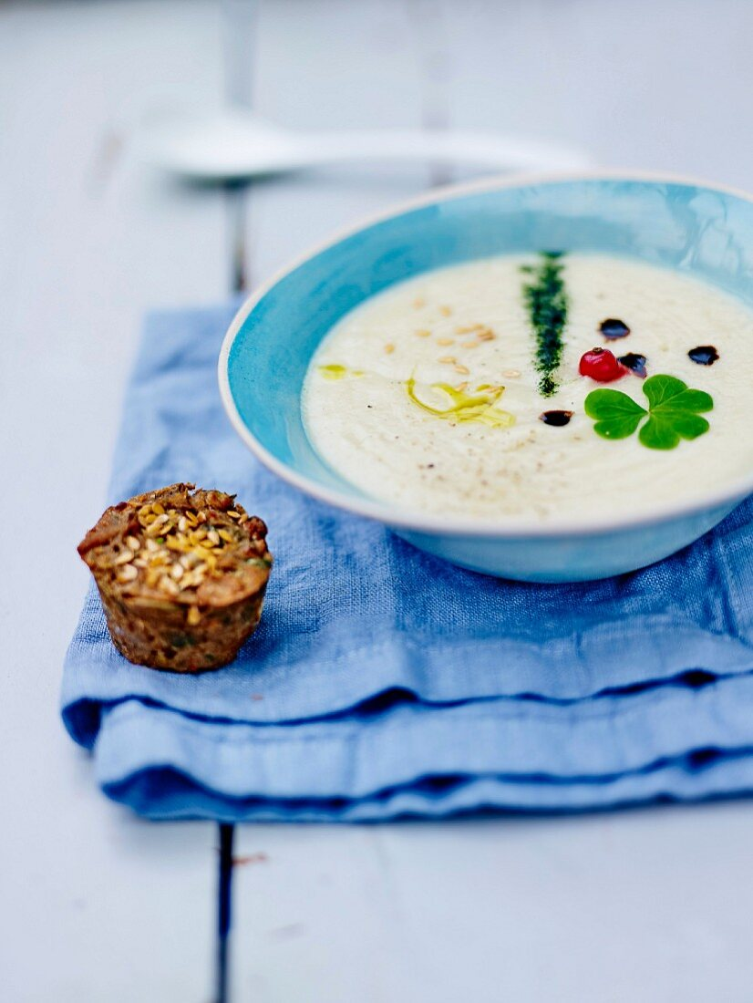 Cream of Jerusalem artichoke soup with a courgette, sun-dried tomato and seed savoury rice flour muffin