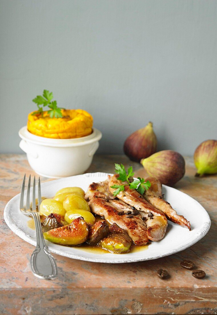 Thinly sliced duck fillets with coffee gravy, stewed figs and glazed Ratte potatoes