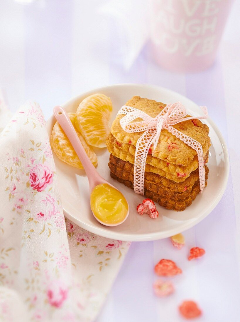 Pink praline biscuits with ugli fruit curd