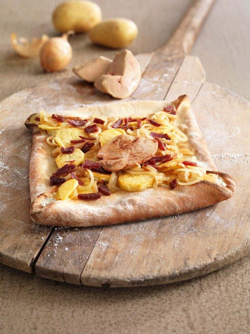 Potato, onion, foie gras and duck gizzard square pizza