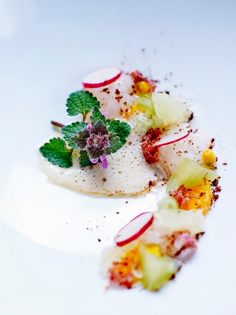 Langoustine bisque and tartare, radishes, pata negra, thin strips of cucumber, diced orange and kiwi with thyme syrup