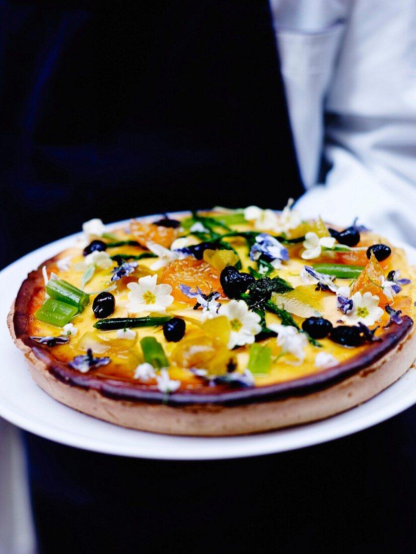 Menton lemon, candied fruit, scrubland flower and black olive tart