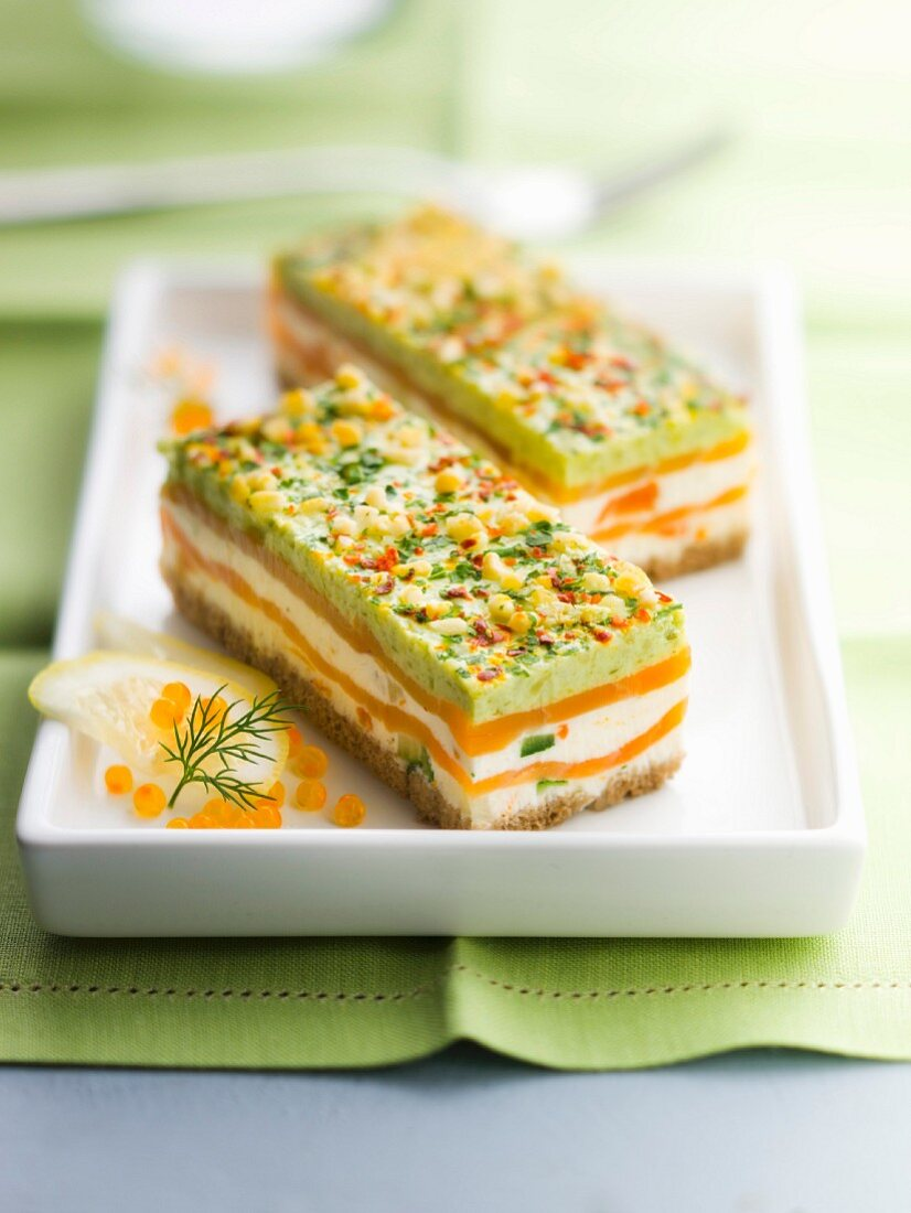 Mille-feuille from smoked salmon, pesto, fromage frais, spring vegetable and white bread