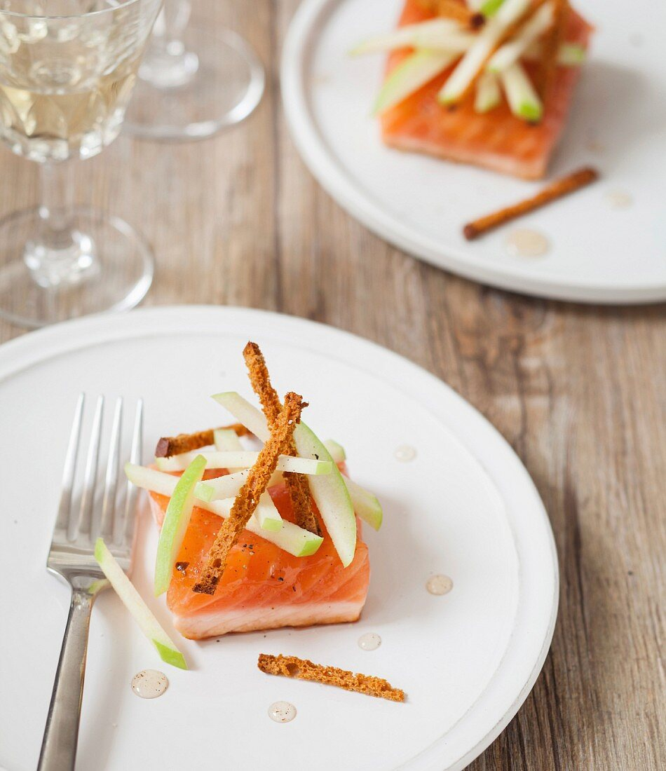 Square salmon tataki with thin strips of Granny Smith apple and peppery acacia spicy honey