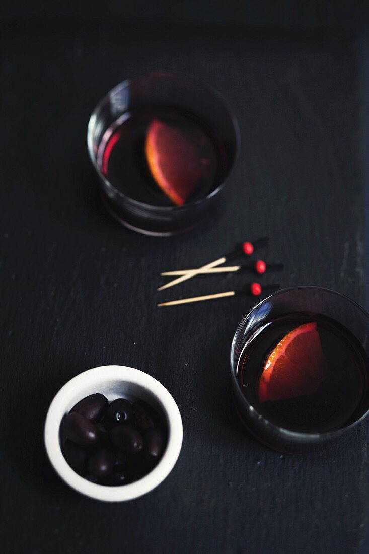 Glasses of Sangria and black olives for an aperitif