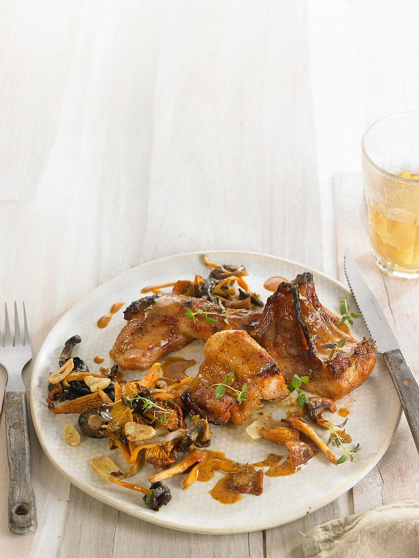Rabbit baked with mustard and honey, pan-fried mushrooms and garlic
