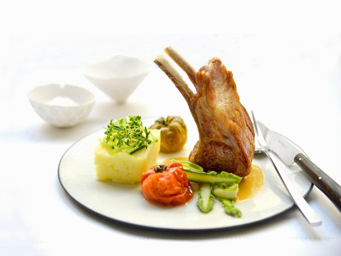 Loin of lamb with orange butter, vegetables and mashed potatoes