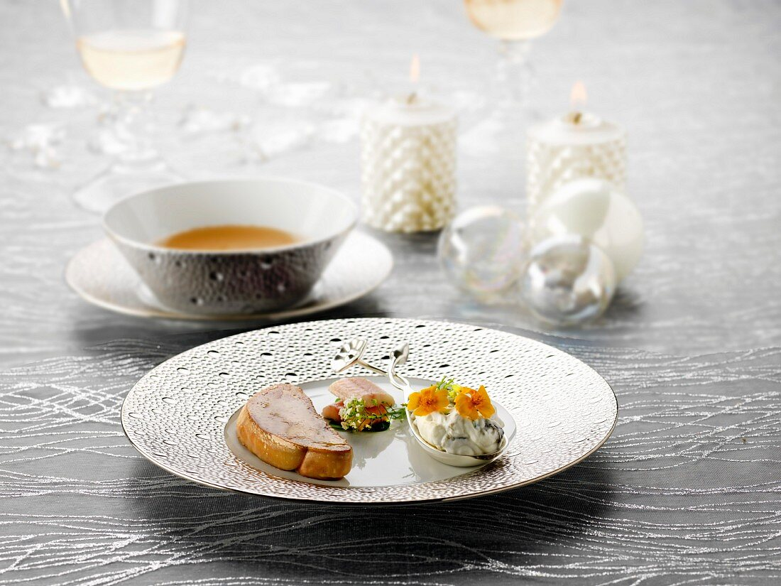 Pan-fried foie gras, whipped cream with seaweed and flowers, raw haddock