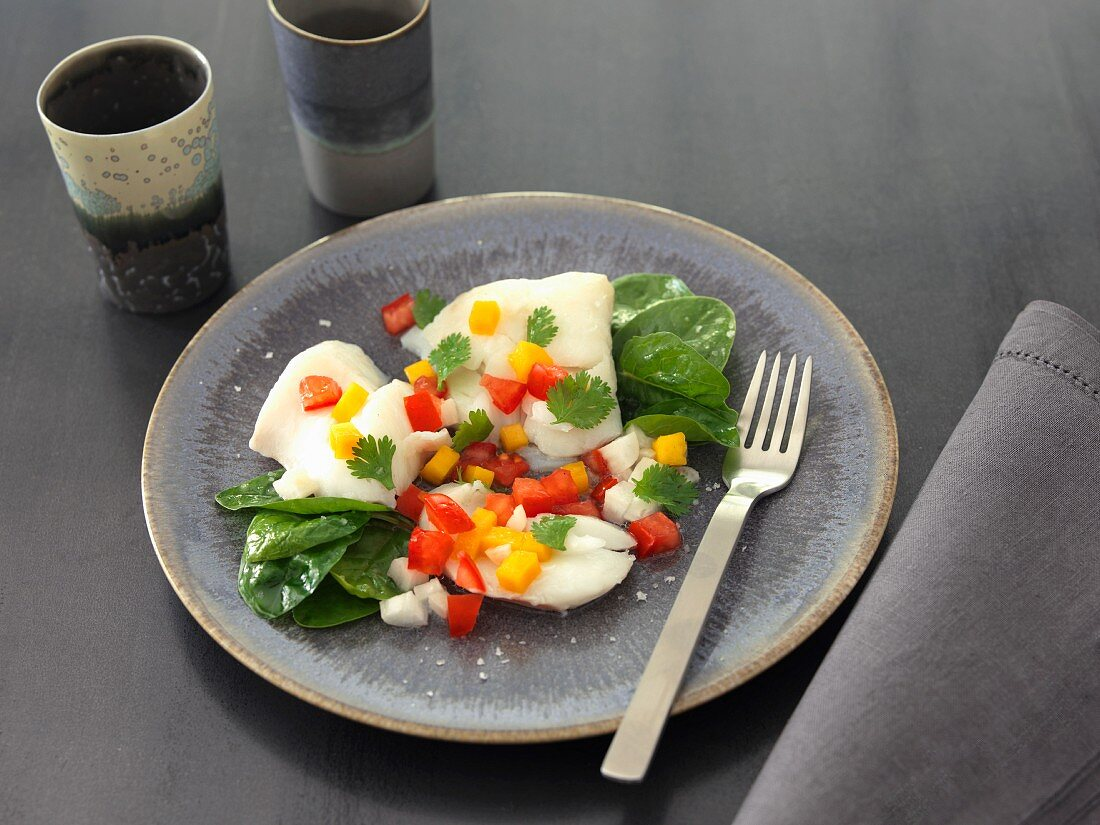 Pollock with red and yellow diced peppers and baby spinach