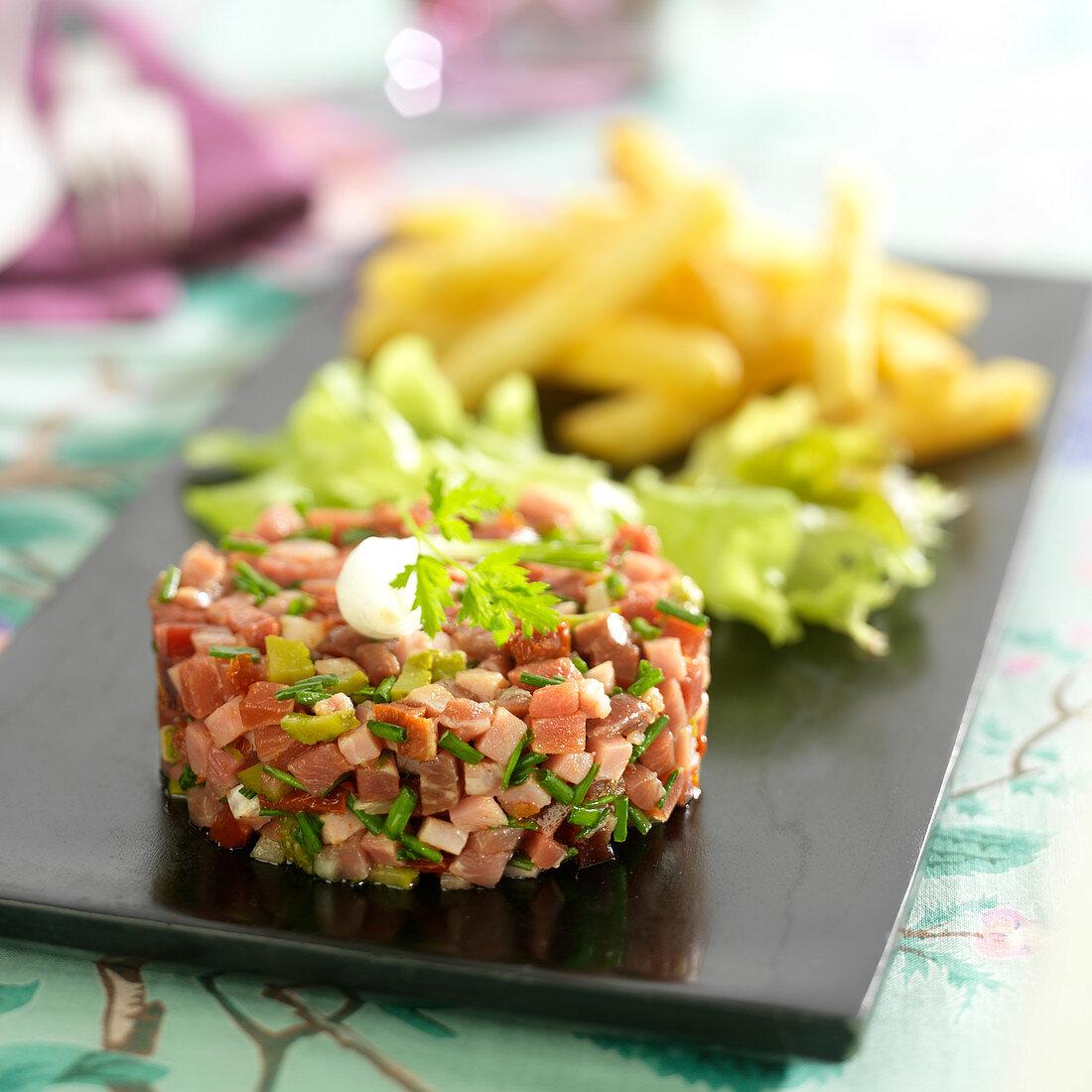 Ham,confit tomato, gherkin and white onion tartare