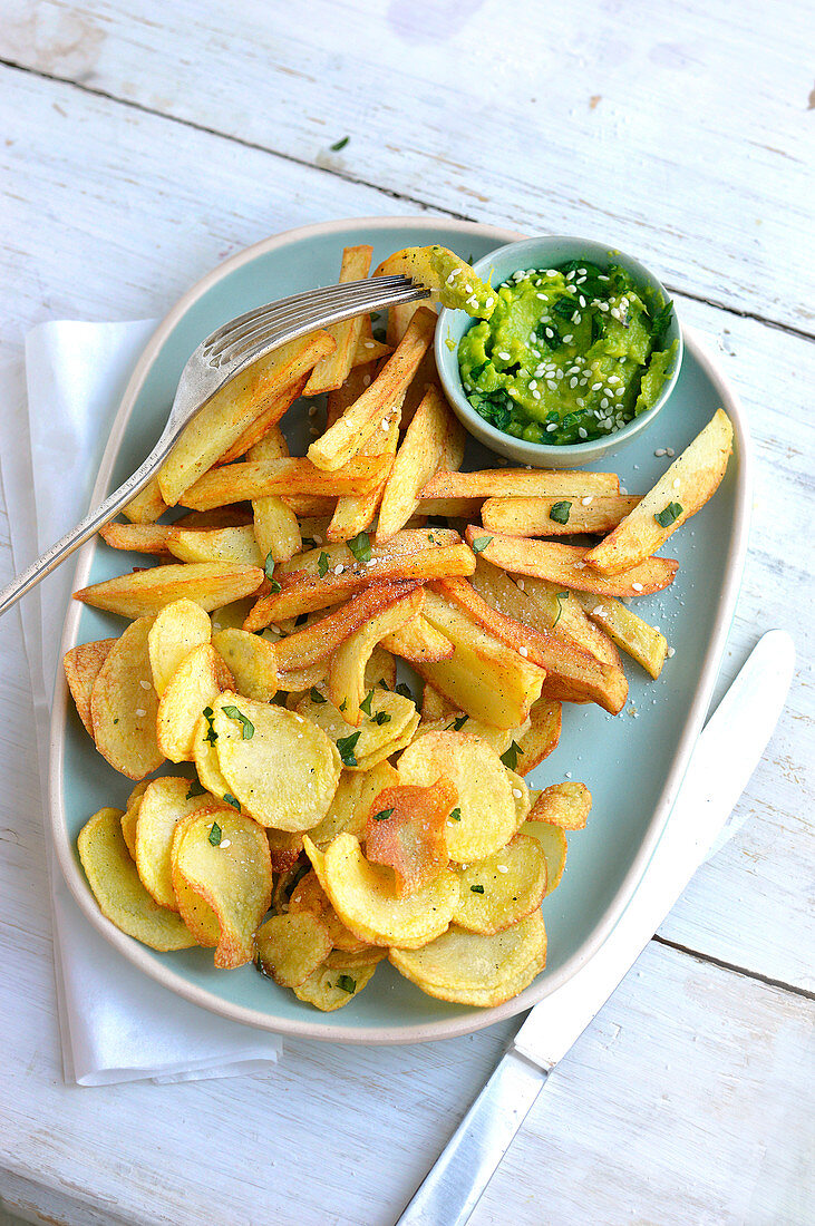 Homemade chips and crisps, guacamole