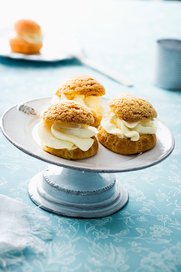 Crisp choux buns garnished with vanilla-flavored whipped cream