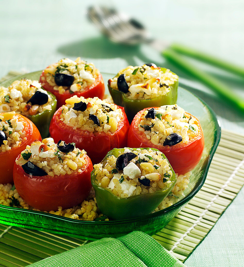 Tomatoes stuffed with bulgur, feta, pine nuts and black olives
