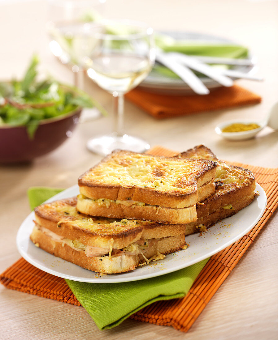 Chicken,curry and artichoke heart toasted and grilled sandwich