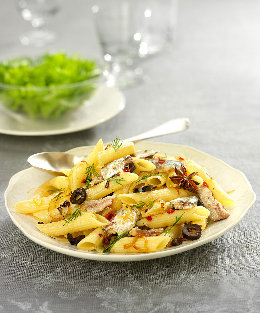 Penne with sardines, olives and star anise