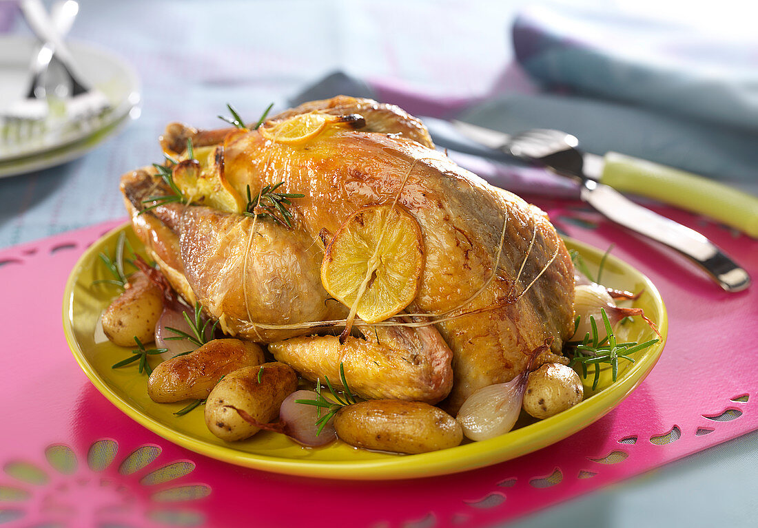 Roasted guinea-fowl with lemon and rosemary, roasted Ratte potatoes with shallots