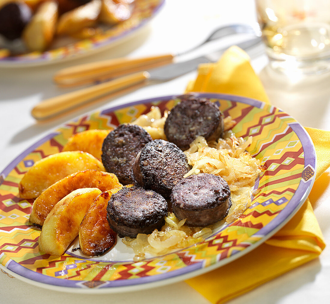 Black pudding with roasted apples and stewed onions