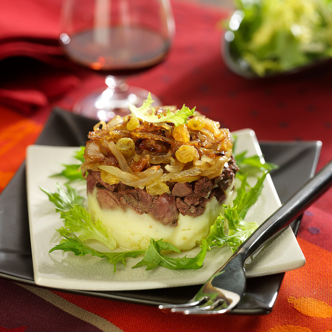 Chopped chicken liver, onion and raisin Parmentier