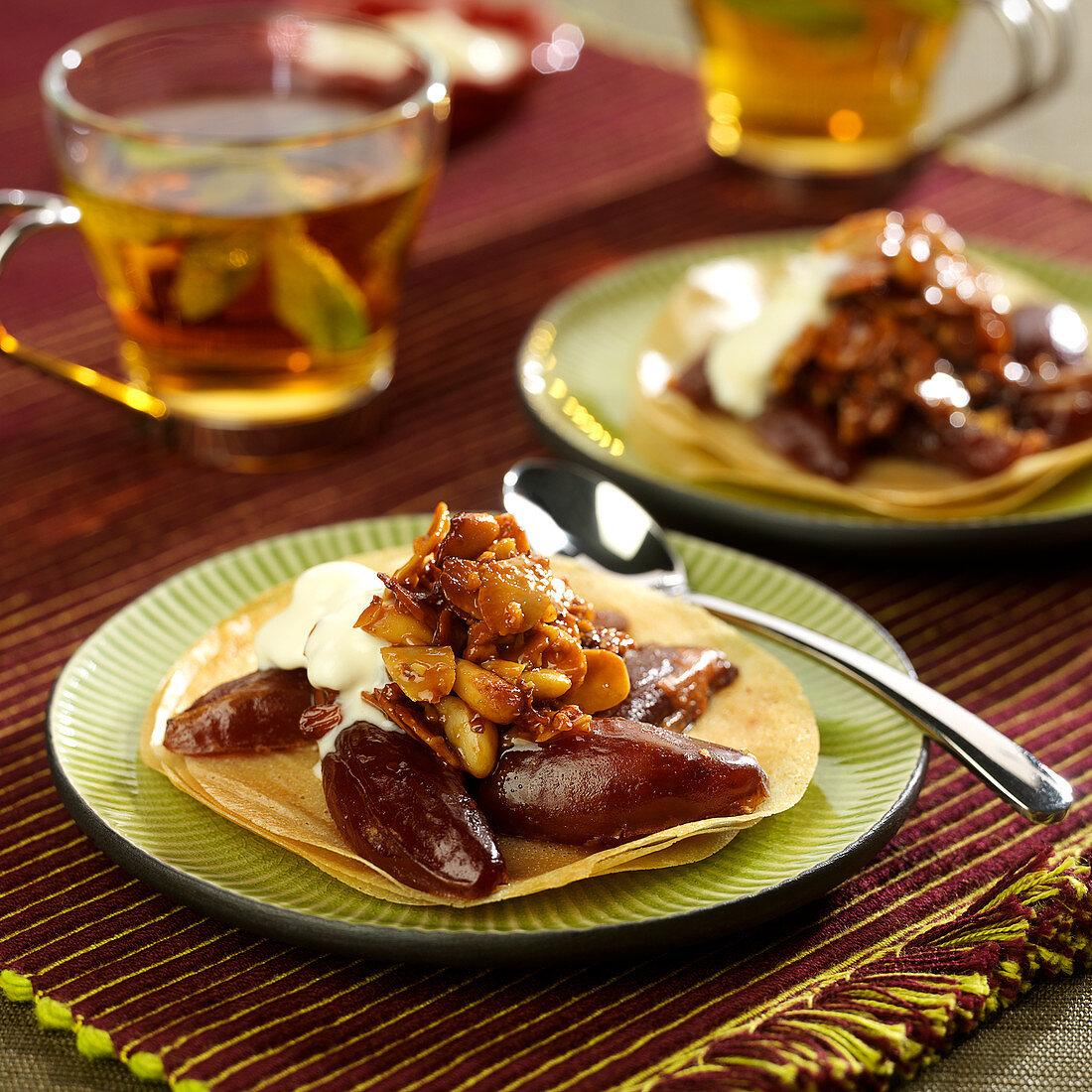 Date, almond, walnut and pine nut honey crisp dessert