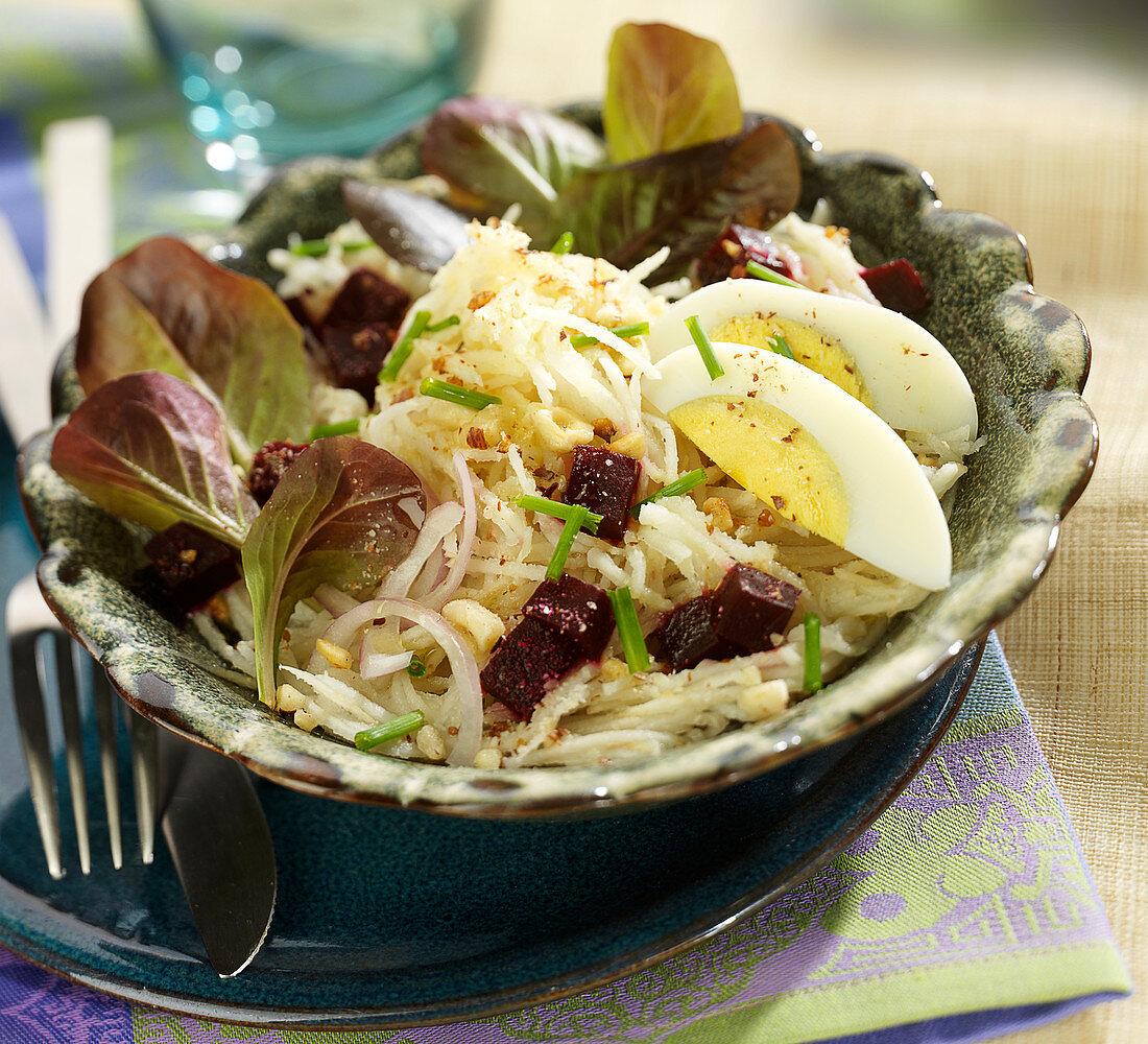 Grated Jerusalem artichoke, beetroot,corn lettuce and hard-boiled egg salad