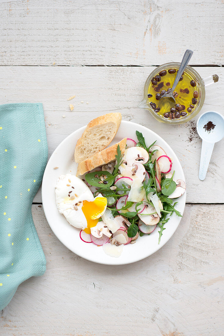 Poached Egg With Radish,Sliced Mushroom,Parmesan Flake And Seed Salad With Olive And Coffee Vinaigrette