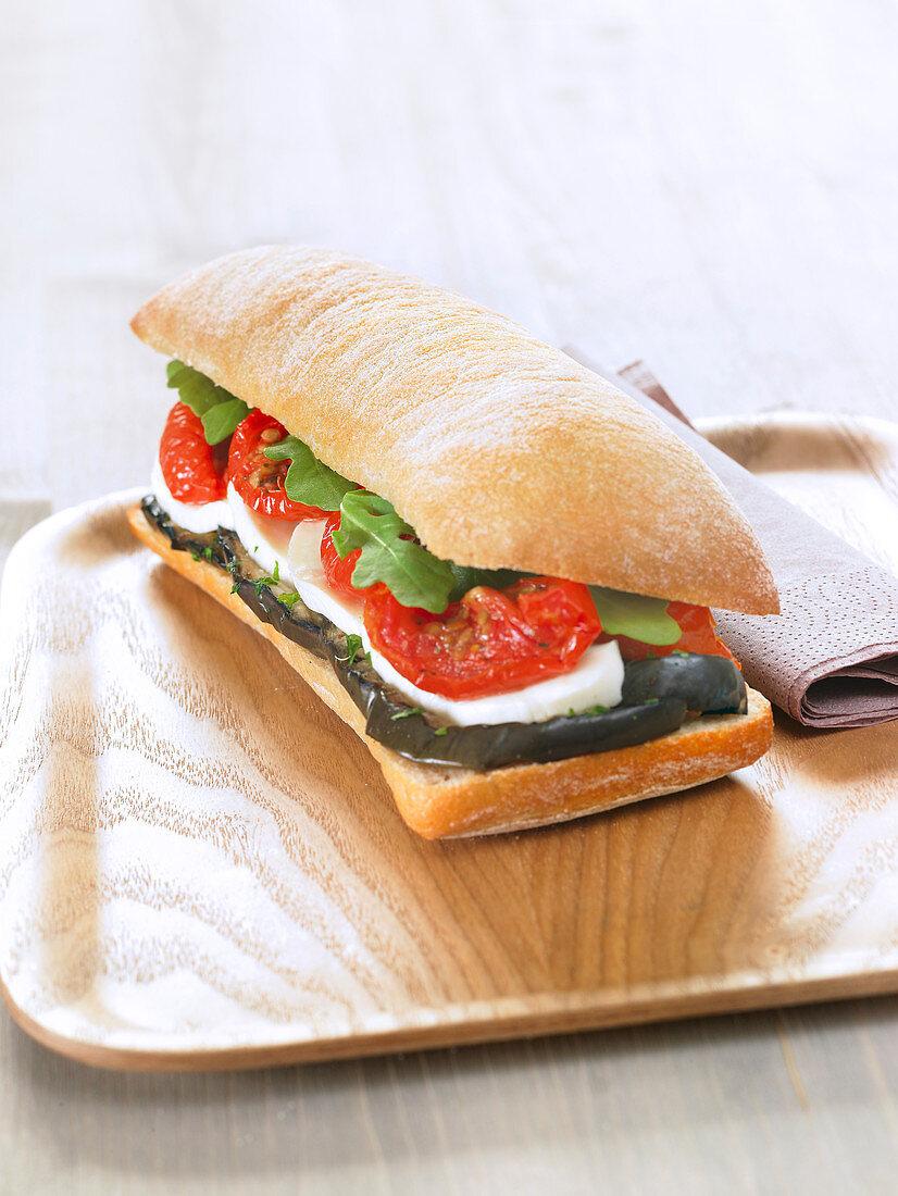 Grilled aubergine, mozzarella, confit tomato and rocket lettuce Ciabatta bread sandwich