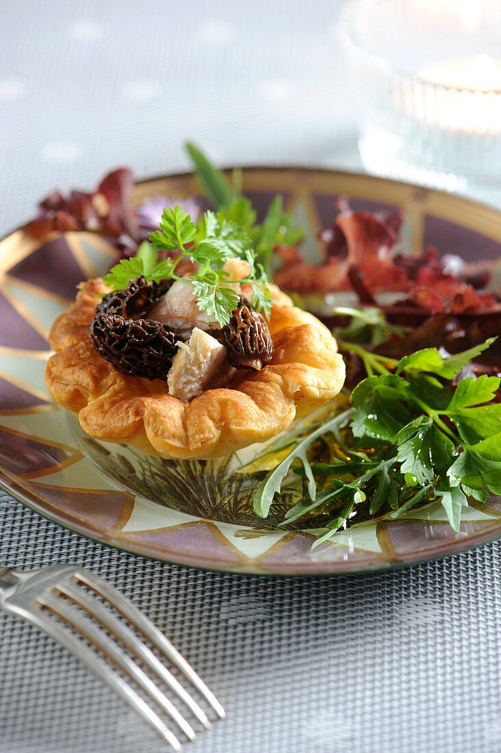 Chicken And Morel Small Flaky Pastry On A Bed Of Mixed Herb Sald