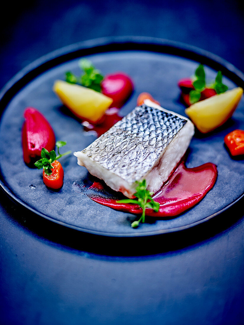 Bass fillet,bitter beetroot puree,yellow beetroot quarters and pepper quenelles