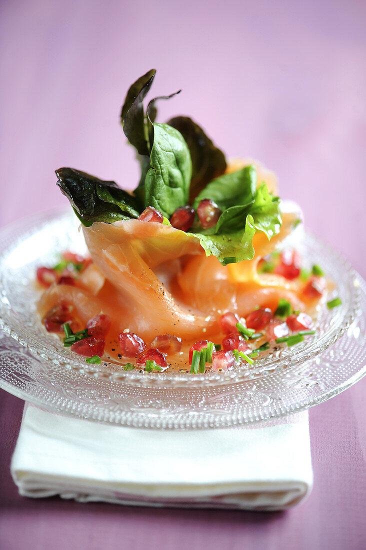 Salmon carpaccio with pomegranate and walnut oil