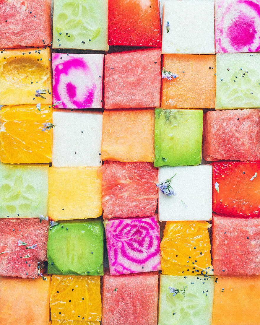 Composition with colored fruit cubes