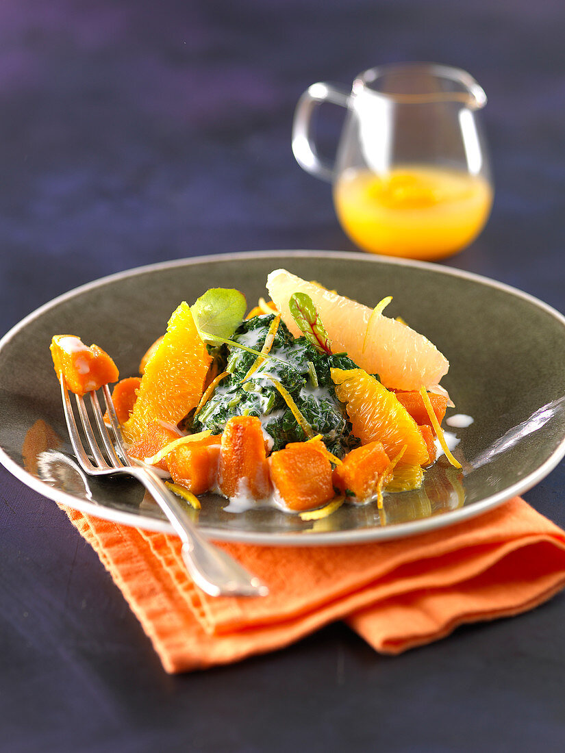 Stewed sweet potatoes with citrus fruit,crushed spinach and cream