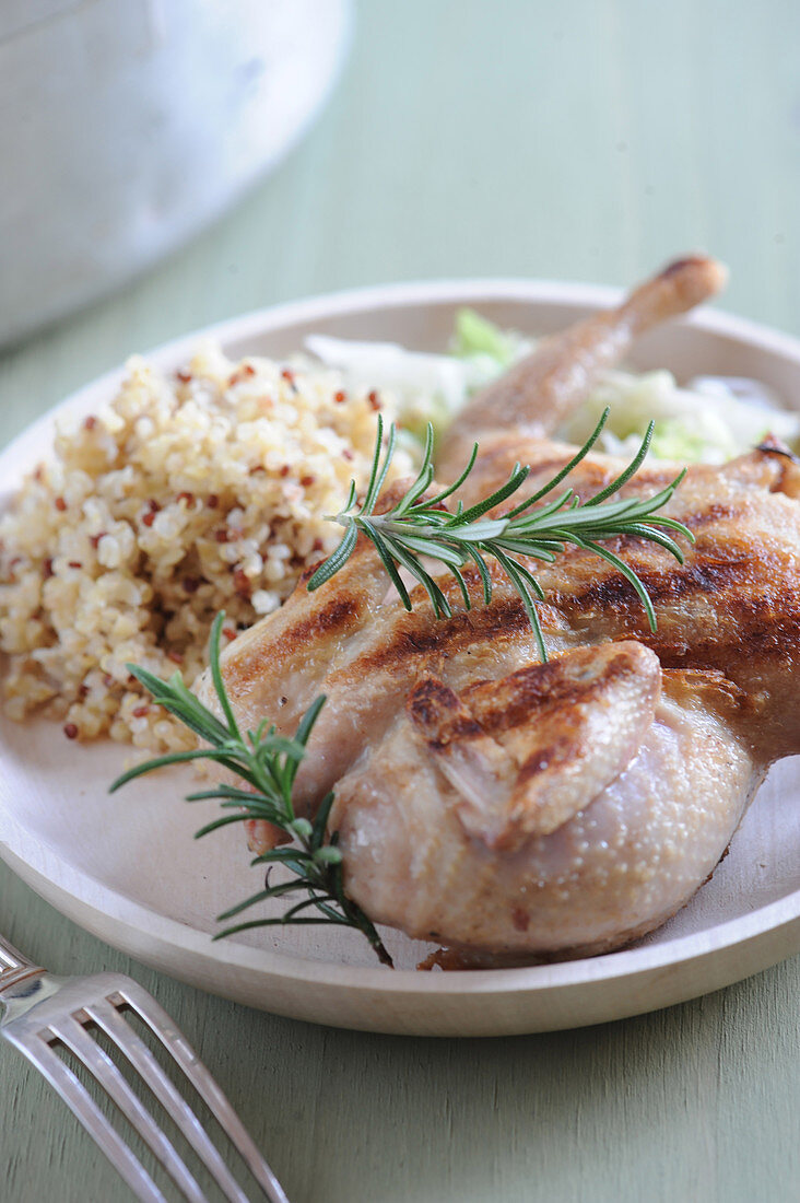 Flattened grilled quail with quinoa