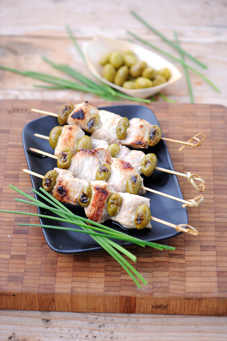 Pork,olive and almond brochettes